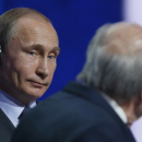 Russian President Vladimir Putin, left, looks to FIFA President Sepp Blatter during the preliminary draw for the 2018 soccer World Cup in Konstantin Palace in St. Petersburg, Russia, Saturday, July 25, 2015. (AP Photo/Dmitry Lovetsky)