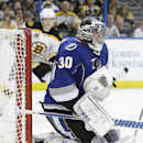 Tampa Bay Lightning goalie Ben Bishop (30) makes a save on a shot by the Boston Bruins during the first period of an NHL hockey game on Saturday, March 8, 2014, in Tampa, Fla The Associated Press