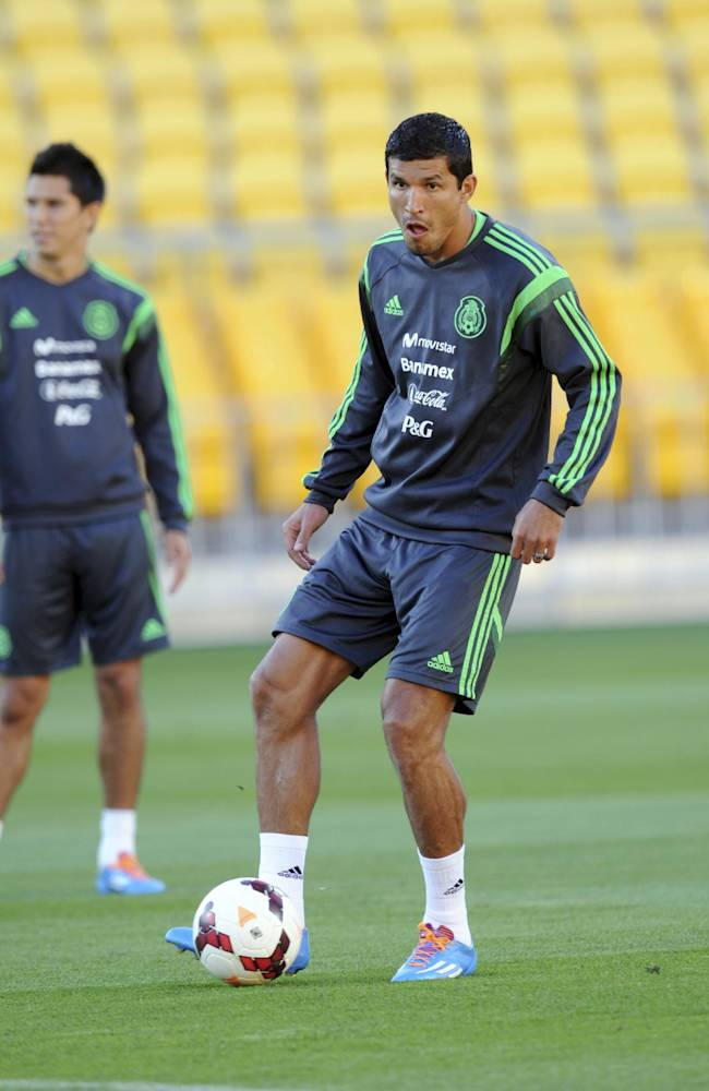 Mexico's Fransico Rodriguez keeps the ball as he takes the team's training for the FIFA World Cup qualifier match against New Zealand in Wellington, New Zealand, Tuesday, Nov. 19, 2013