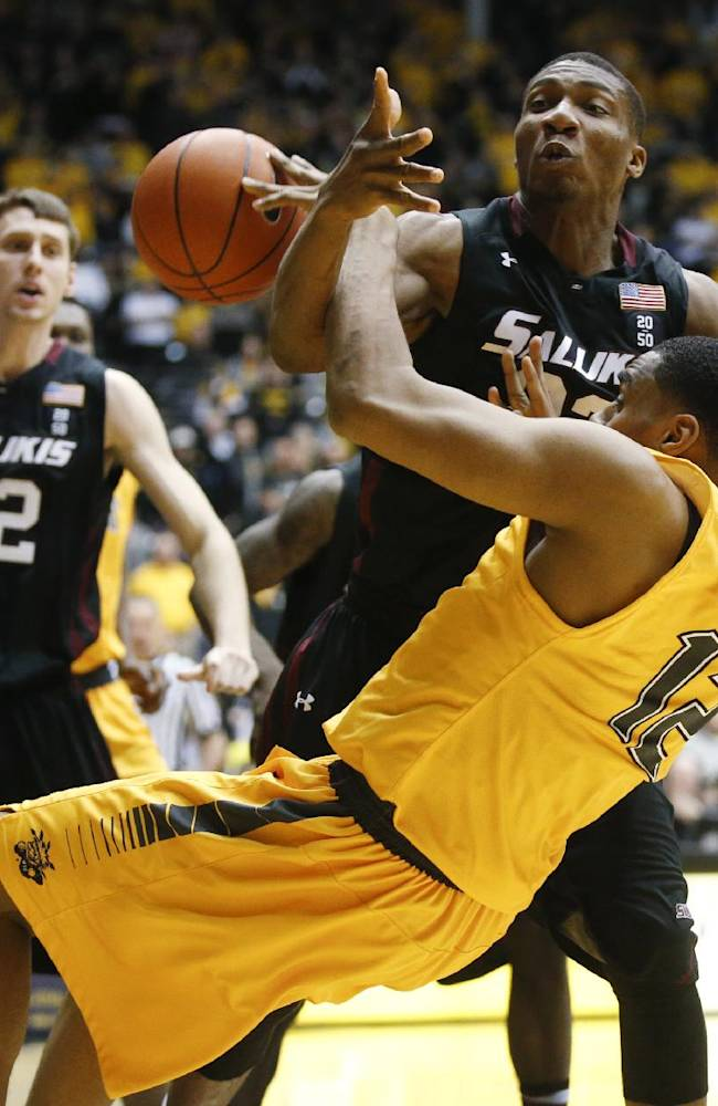 Wichita State's Darius Carter (12) and Southern Illinois' Bola Olaniyan scramble for the ball during the second half of an NCAA college basketball game Tuesday, Feb. 11, 2014, in Wichita, Kan
