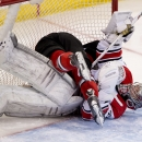Ottawa Senators Kyle Turris crashes into Carolina Hurricanes goalie Cam Ward during third period NHL action Monday, March 31, 2014, in Ottawa, Ontario. The Senators Defeated the Hurricanes in a shoot-out The Associated Press