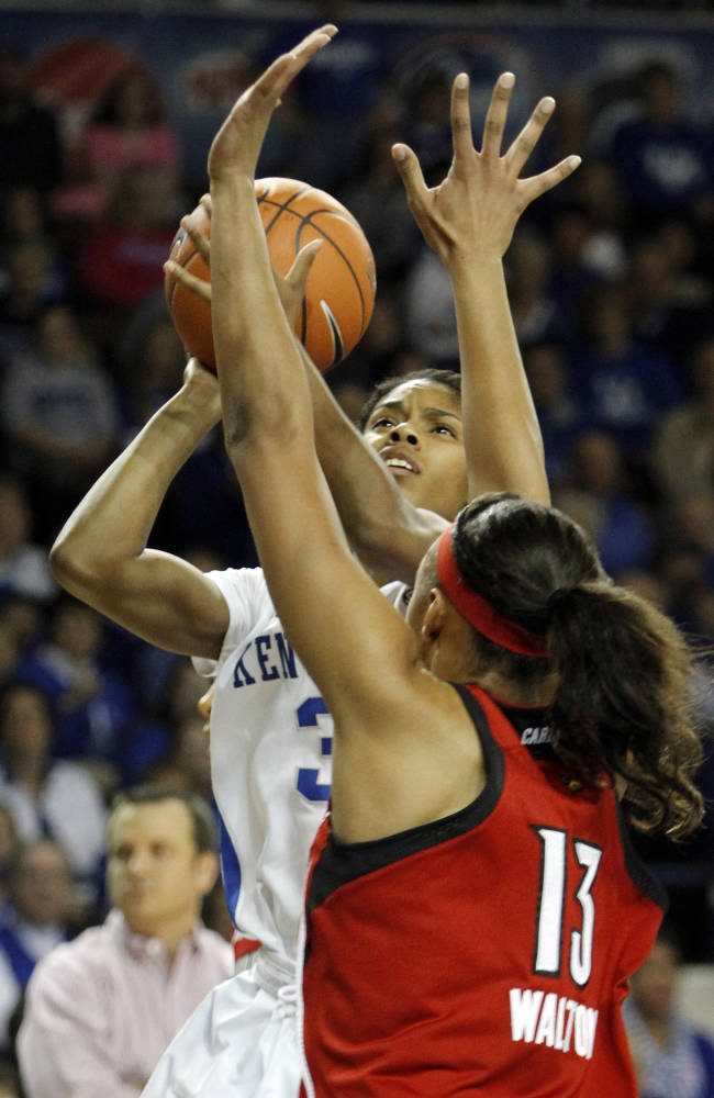 Kentucky's Janee Thompson (3) shoots under pressure from Louisville's Cortnee Walton (13) during the first half of an NCAA college basketball game, Sunday, Dec. 1, 2013, in Lexington, Ky