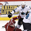 San Jose Sharks' Jason Demers (5) checks Phoenix Coyotes' Lauri Korpikoski (28), of Finland, to the ice during the third period of an NHL hockey game on Saturday, April 12, 2014, in Glendale, Ariz. The Sharks defeated the Coyotes 3-2 The Associated Press