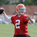 Cleveland Browns quarterback Johnny Manziel passes during practice at the NFL football team's facility in Berea, Ohio Wednesday, Aug. 20, 2014. (AP Photo/Mark Duncan)