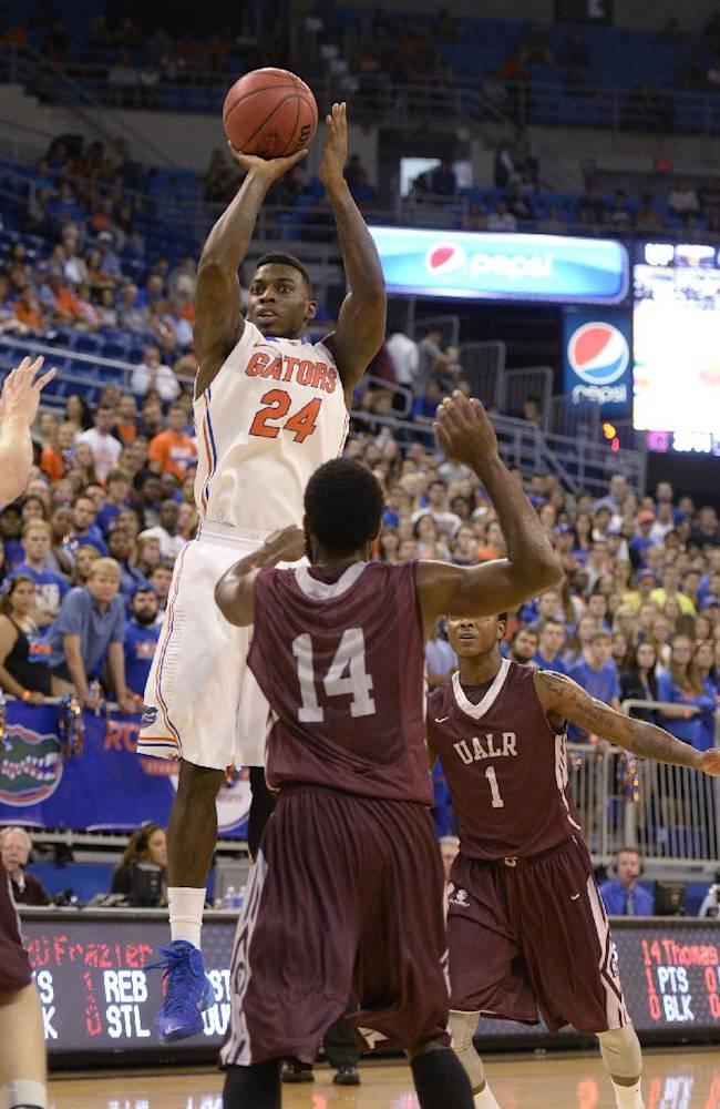 Florida forward Casey Prather (24) goes up for a shot in front of Arkansas-Little Rock guard J.T. Thomas (14)  during the first half of an NCAA college basketball game Saturday, Nov. 16, 2013, in Gainesville, Fla