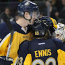 Buffalo Sabres' Tyler Myers (57) and Tyler Ennis (63) celebrate their 2-1 victory over the Tampa Bay Lightning following an NHL hockey game Tuesday, Dec. 2, 2014, in Buffalo, N.Y The Associated Press