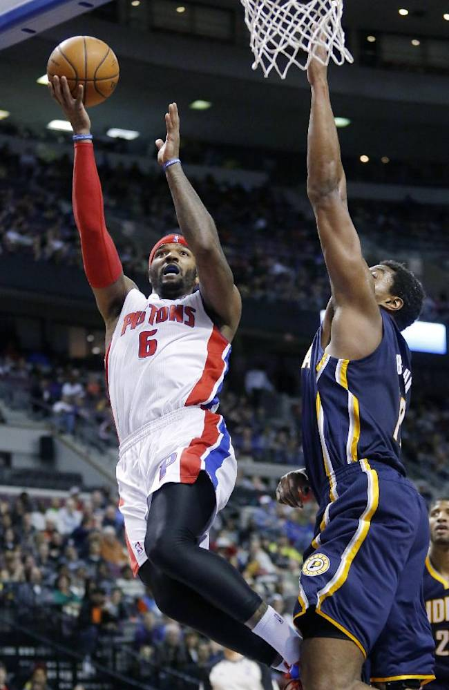 Detroit Pistons forward Josh Smith (6) goes to the basket against Indiana Pacers Andrew Bynum (17) during the second half of an NBA basketball game Saturday, March 15, 2014, in Detroit. Smith led the Pistons with 23 points. The Pacers defeated the Pistons in overtime 112-104