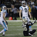 New Orleans Saints cornerback Rod Sweeting (38) reacts as Carolina Panthers kicker Graham Gano (9) misses a field goal as holder Brad Nortman (8) watches in the second half of an NFL football game in New Orleans, Sunday, Dec. 8, 2013 The Associated Press