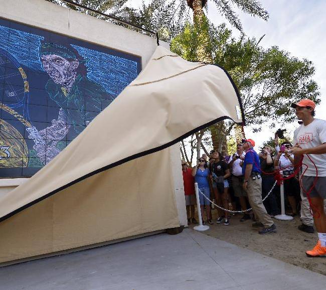 Rafael Nadal, of Spain, unveils a mural of himself by artist Mike Sullivan in front of stadium court at the BNP Paribas Open tennis tournament, Tuesday, March 4, 2014, in Indian Wells, Calif