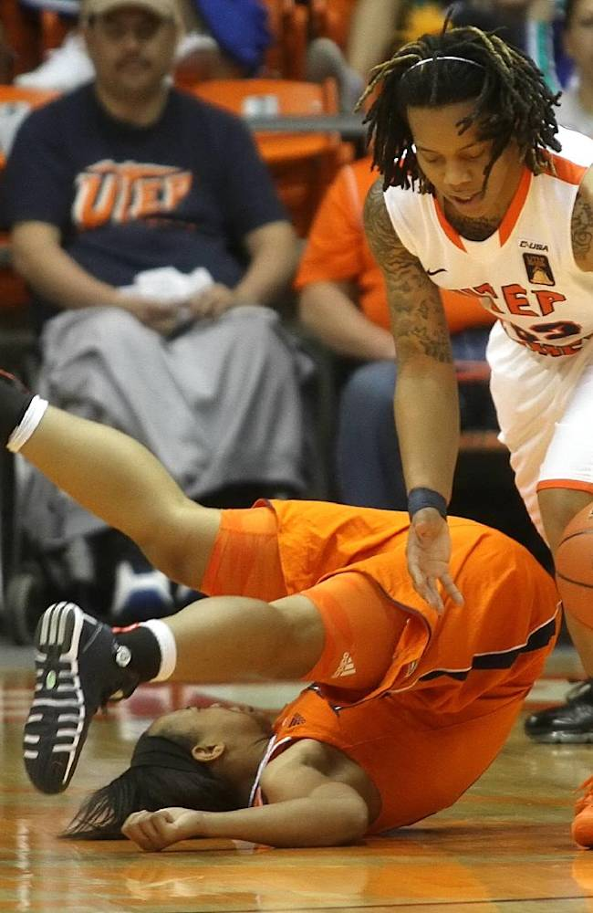UTEP's Chrishauna Parker heads upcourt after scooping up a loose ball in front of Texas-San Antonio's Alana Heard Wednesday, Feb. 27, 2014