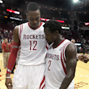 Houston Rockets' Dwight Howard (12) and Pat Beverley (2) walk off the court after the Rockets defeated the New Orleans Pelicans 111-104 during an NBA basketball game, Saturday, April 12, 2014, in Houston The Associated Press
