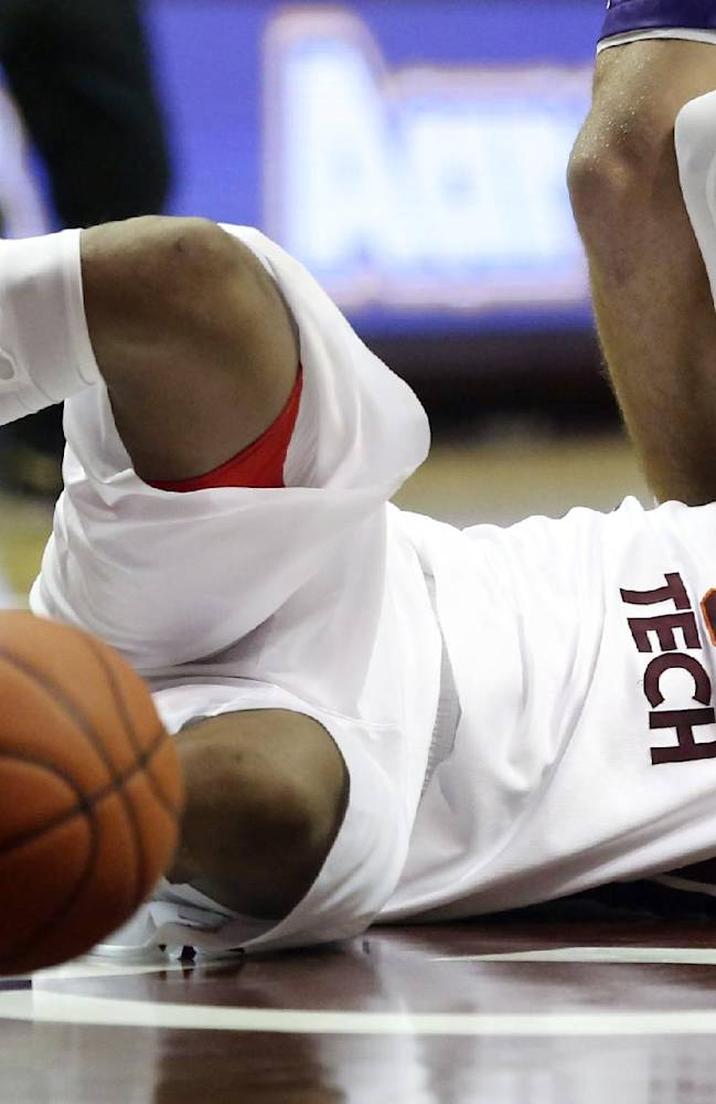 Virginia Tech's Jarell Eddie (31) its the floor while attempting to get a defensive rebound during first half of an NCAA college basketball game against Furman Tuesday, Nov. 26 2013, Blacksburg, Va. (AP photo / The Roanoke Times, Matt Gentry)