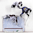 St. Louis Blues' Chris Stewart (25) scores past Colorado Avalanche goalie Semyon Varlamov, of Russia, and Cory Sarich (16) during the second period of an NHL hockey game Thursday, Nov. 14, 2013, in St. Louis The Associated Press