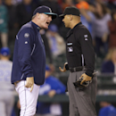Seattle Mariners manager Eric Wedge disputes a call at home plate with umpire Vic Carapazza during the tenth inning of a baseball game against the Kansas City Royals, Monday, Sept. 23, 2013, in Seattle. Carapazza called the Mariners' potential game winning run out at home to end the inning. (AP Photo/Stephen Brashear)