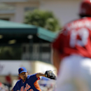New York Mets starting pitcher Daisuke Matsuzaka, left, throws as St. Louis Cardinals' Matt Carpenter takes a lead off third during the first inning of a spring training baseball game Sunday, March 2, 2014, in Jupiter, Fla The Associated Press