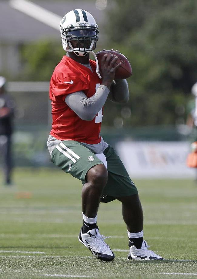 New York Jets quarterback Michael Vick throws a pass during the Jets NFL football training camp Thursday, July 24, 2014, in Cortland, N.Y.  (AP Photo)