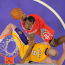 Houston Rockets forward Terrence Jones, top, puts up a shot as Los Angeles Lakers center Chris Kaman defends during the second half of an NBA basketball game, Wednesday, Feb. 19, 2014, in Los Angeles The Associated Press