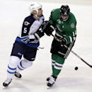 Winnipeg Jets defenseman Mark Stuart (5) and Dallas Stars left wing Jamie Benn (14) battle for control of the puck during the first period of an NHL hockey game Monday, March 24, 2014, in Dallas The Associated Press