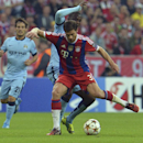Manchester City's Yaya Toure, rear, and Bayern's Xabi Alonso challenge for the ball during the Champions League group E soccer match between Bayern Munich and Manchester City in Munich, Germany, Wednesday Sept.17,2014