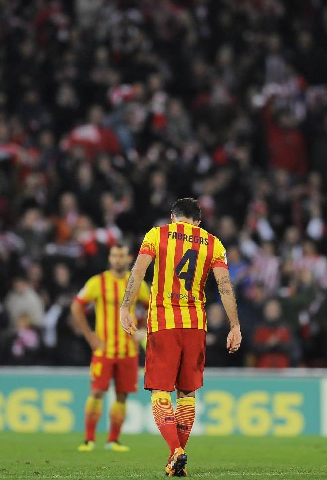 Barcelona's Neymar da Silva of Brazil, right, laments, after Athletic Bilbao scored their goal, beside his fellow teammmate, Francesc Fabregas, center, and Sergio Busquets, left back, during their Spanish League soccer match, at San Mames stadium in Bilbao, Spain, Sunday, Dec. 1, 2013. F.C. Barcelona lost the match 1-0