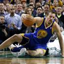 Golden State Warriors forward David Lee (10) lands on Boston Celtics point guard Rajon Rondo as he handles the ball in the first half of an NBA basketball game in Boston, Wednesday, March 5, 2014. (AP Photo/Elise Amendola)