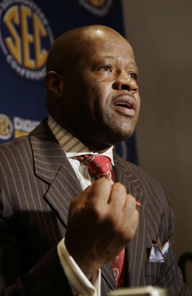 Arkansas coach Mike Anderson talks with reporters at the Southeastern Conference NCAA college basketball media day in Birmingham, Ala., Thursday, Oct. 17, 2013