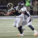 St. Louis Rams running back Tre Mason, left, catches a pass for a short gain as Denver Broncos linebacker Brandon Marshall defends during the third quarter of an NFL football game Sunday, Nov. 16, 2014, in St. Louis. (AP Photo/Tom Gannam)