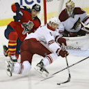 Florida Panthers' Tomas Fleischmann (14) and Arizona Coyotes' Connor Murphy (5) battle for the puck during the third period of a NHL hockey game in Sunrise, Fla., Thursday, Oct. 30, 2014. The Panthers won 2-1 The Associated Press
