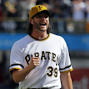 Pittsburgh Pirates closer Jason Grilli celebrates getting the final out of the ninth inning to end a baseball game against the St. Louis Cardinals in Pittsburgh, Sunday, April 6, 2014. The Pirates won 2-1 The Associated Press