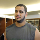In this May 10, 2013 file photo, New York Jets' Oday Aboushi talks to the media in the locker room after NFL football practice in Florham Park, N.J. Aboushi was part of a five-day surgical mission by the Islamic Medical Association of North America in ea
