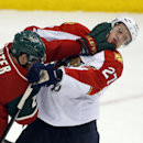 Florida Panthers' Nick Bjugstad (27) and Minnesota Wild's Ryan Suter (20) mix it up during the Wild's 3-2 win in an NHL hockey game on Friday, Nov. 15, 2013, in St. Paul, Minn The Associated Press