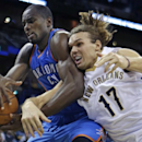 Oklahoma City Thunder power forward Serge Ibaka battles for a rebound with New Orleans Pelicans power forward Lou Amundson (17) in the second half of an NBA basketball game in New Orleans, Friday, Dec. 6, 2013. The Thunder won 109-95 The Associated Press