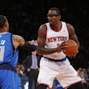 New York Knicks' Amar'e Stoudemire (1) controls the ball against Dallas Mavericks' Monta Ellis during the first half of an NBA basketball game, Monday, Feb. 24, 2014, in New York. Dallas won 110-108 The Associated Press