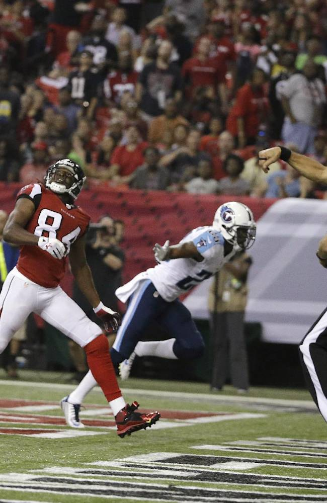 In this Aug. 23, 2014, file photo, Atlanta Falcons wide receiver Roddy White (84) waits for the ball as back judge Tony Steratore throws a penalty flag against the Tennessee Titans during the first half of an NFL preseason football game in Atlanta. There has been a jump in the number of penalties called for illegal contact, defensive holding and illegal use of hands in preseason games this year
