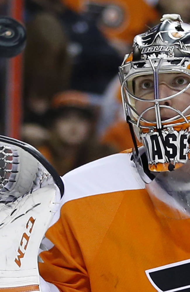 Philadelphia Flyers' Steve Mason catches a shot during the first period of an NHL hockey game against the Columbus Blue Jackets, Thursday, April 3, 2014, in Philadelphia
