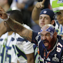 A New England Patriots fan cheers before the NFL Super Bowl XLIX football game between the Seattle Seahawks and the Patriots on Sunday, Feb. 1, 2015, in Glendale, Ariz The Associated Press