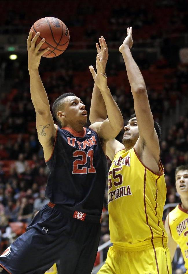 Utah's Jordan Loveridge (21) shoots as Southern California's Omar Oraby (55), of Egypt, defends in the second half during an NCAA basketball game Thursday, Jan. 16, 2014, in Salt Lake City. Utah won 84-66