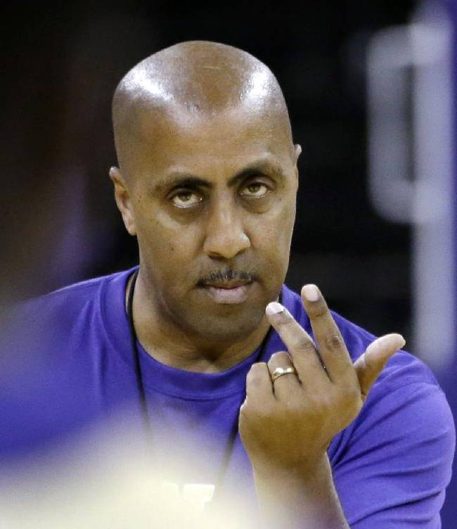 Washington coach Lorenzo Romar signals to players during the NCAA college basketball team's practice Tuesday, Oct. 8, 2013, in Seattle. As the Huskies begin the 2013-14 season, changes abound, from new additions to the coaching staff to a roster that including six new faces that were not able to play for the program a season ago
