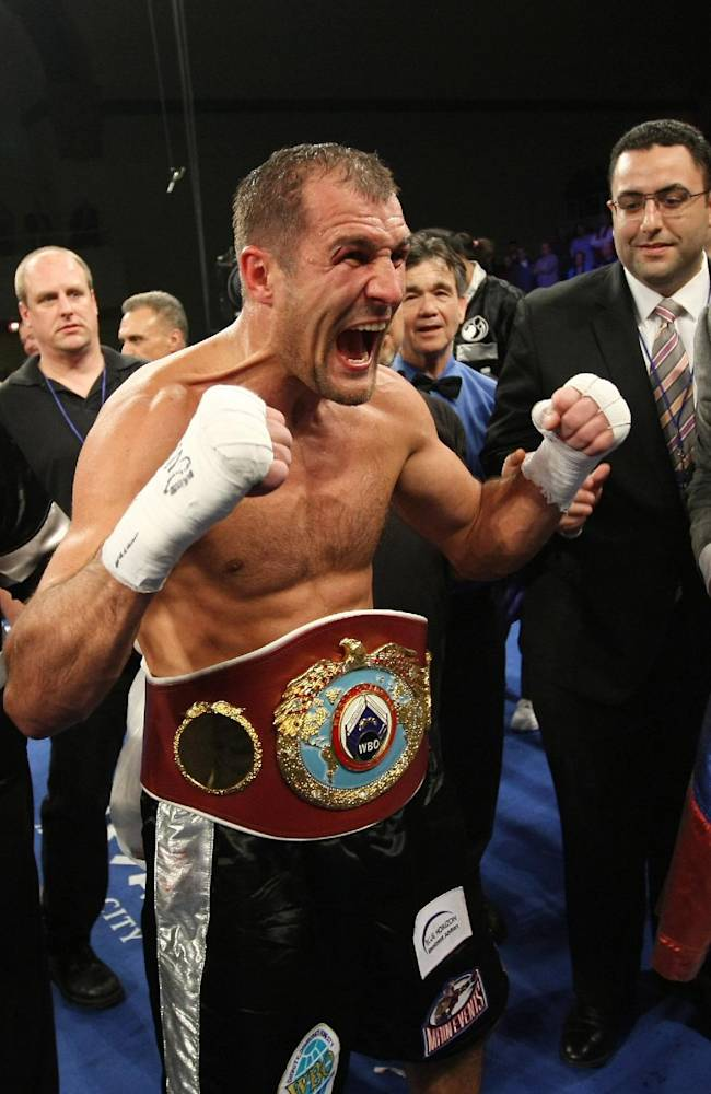 Sergey Kovalev, of Russia, reacts after defeating Cedric Agnew, of the United States, by knockout in the seventh round of WBO light heavyweight championship boxing match in Atlantic City, N.J., on Saturday, March 29, 2014
