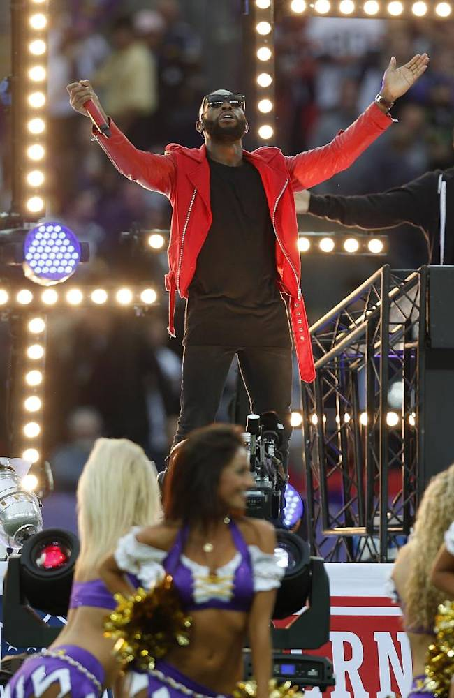 British rapper Tinie Tempah, center, performs ahead of the NFL game between the Pittsburgh Steelers and Minnesota Vikings  at Wembley Stadium, London, Sunday, Sept. 29, 2013
