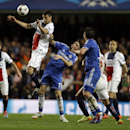 PSG's Thiago Motta jumps for an header ahead of Chelsea's Oscar and Frank Lampard during the Champions League second leg quarterfinal soccer match between Chelsea and Paris Saint-Germain at Stamford Bridge Stadium in London, Tuesday, April 8, 2014