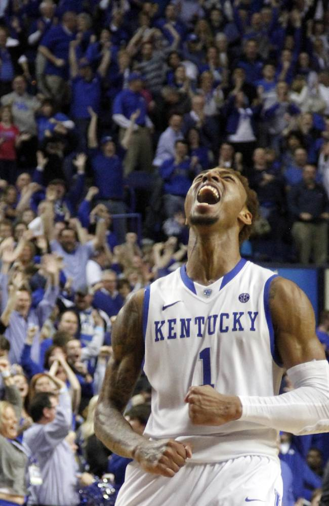 Kentucky's James Young (1) celebrates after Kentucky's 77-76 overtime win in an NCAA college basketball game against LSU, Saturday, Feb. 22, 2014, in Lexington, Ky