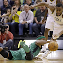 Boston Celtics' Rajon Rondo, left, and Utah Jazz's Alec Burks, right, chase a loose ball in the second half of an NBA basketball game, Monday, Feb. 24, 2014, in Salt Lake City. The Jazz won 110-98 The Associated Press