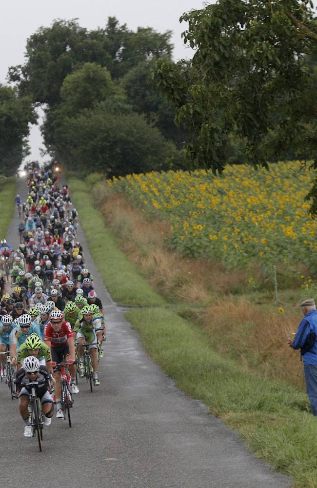 China's Cheng Ji leads the pack as it chases after a breakaway of five riders during the nineteenth stage of the Tour de France cycling race over 208.5 kilometers (129.6 miles) with start in Maubourguet and finish in Bergerac, France, Friday, July 25, 2014