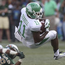 North Texas wide receiver Darius Terrell (11) is tripped up by UAB safety Jay Davis (8) during the first half of an NCAA college football game at Legion Field, Saturday, Oct. 11, 2014, in Birmingham, Ala The Associated Press