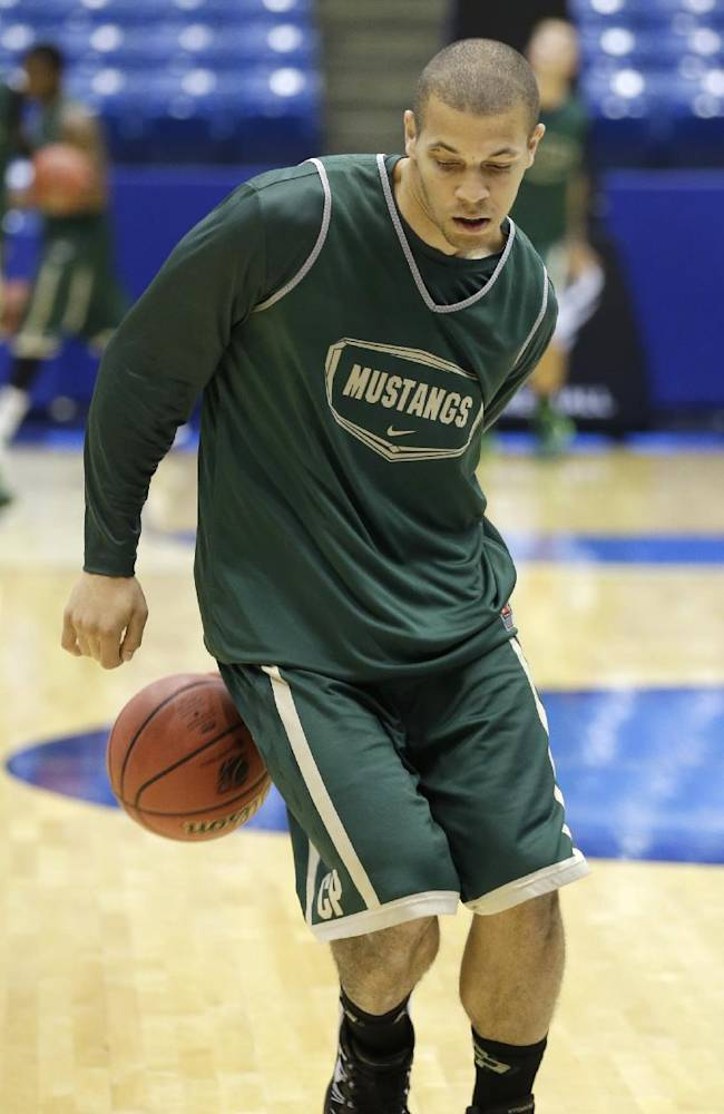 Cal Poly forward Chris Eversley dribbles behind his back during practice for an NCAA college basketball tournament game, Tuesday, March 18, 2014, in Dayton, Ohio. Cal Poly plays Texas Southern Wednesday evening in a first round game