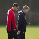Manchester United's manager David Moyes, right, walks alongside defender Rio Ferdinand as the team trains at Carrington training ground in Manchester, Monday, Dec. 9, 2013. Manchester United will play Shakhtar Donetsk in a Champion's League Group A soccer