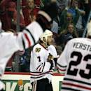 Chicago Blackhawks defenseman Brent Seabrook (7) celebrates his goal against the Colorado Avalanche in the second period of an NHL hockey game in Denver, Saturday, Dec. 27, 2014. (AP Photo/Joe Mahoney)