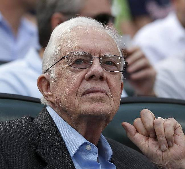 In this May, 17, 2013 file photo, former U.S. President Jimmy Carter watches a baseball game between Atlanta Braves and Los Angeles Dodgers in Atlanta. Speaking at a daylong symposium on capital punishment at the Carter Center in Atlanta Tuesday, Nov. 11, 2013  Carter said there are unfair racial, economic and geographic disparities in the application of the death penalty