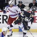 New York Rangers' Rick Nash (61) collides with Pittsburgh Penguins' Chris Kunitz (14) during the first period of an NHL hockey game in Pittsburgh, Sunday, Jan. 18, 2015. The Rangers won 5-2 The Associated Press